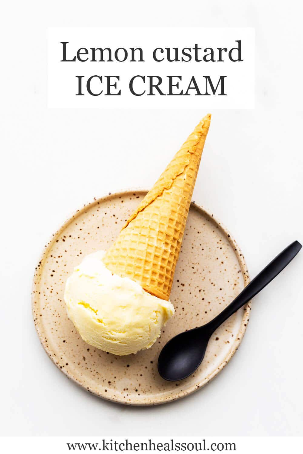Lemon custard ice cream in a cone served on a ceramic plate with a black spoon