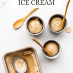 Masala chai ice cream frozen in a loaf pan and being scooped into little blue cups and served with wooden spoons