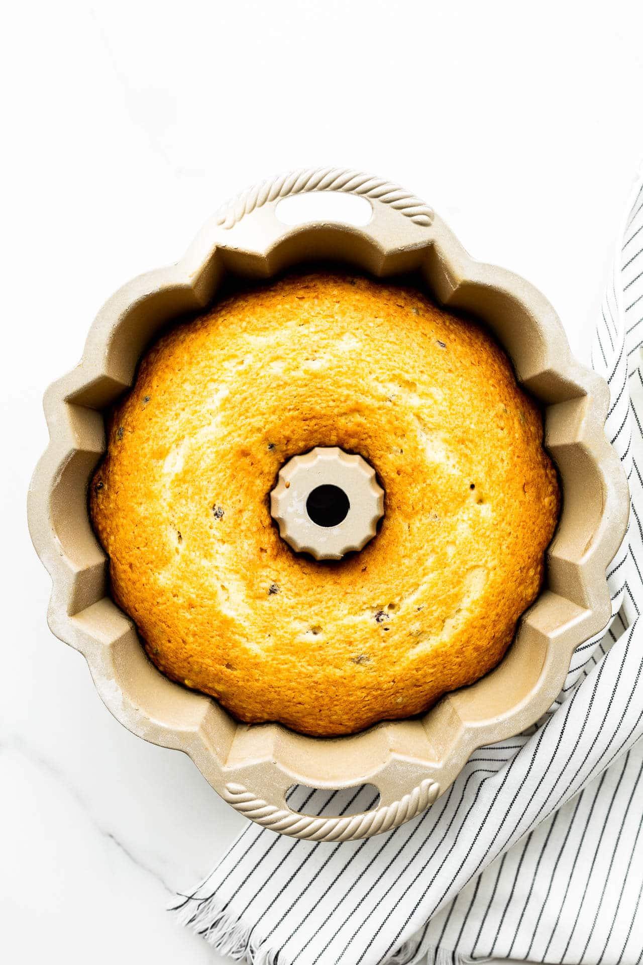 Freshly baked bundt cake in bundt pan before unmoulding.