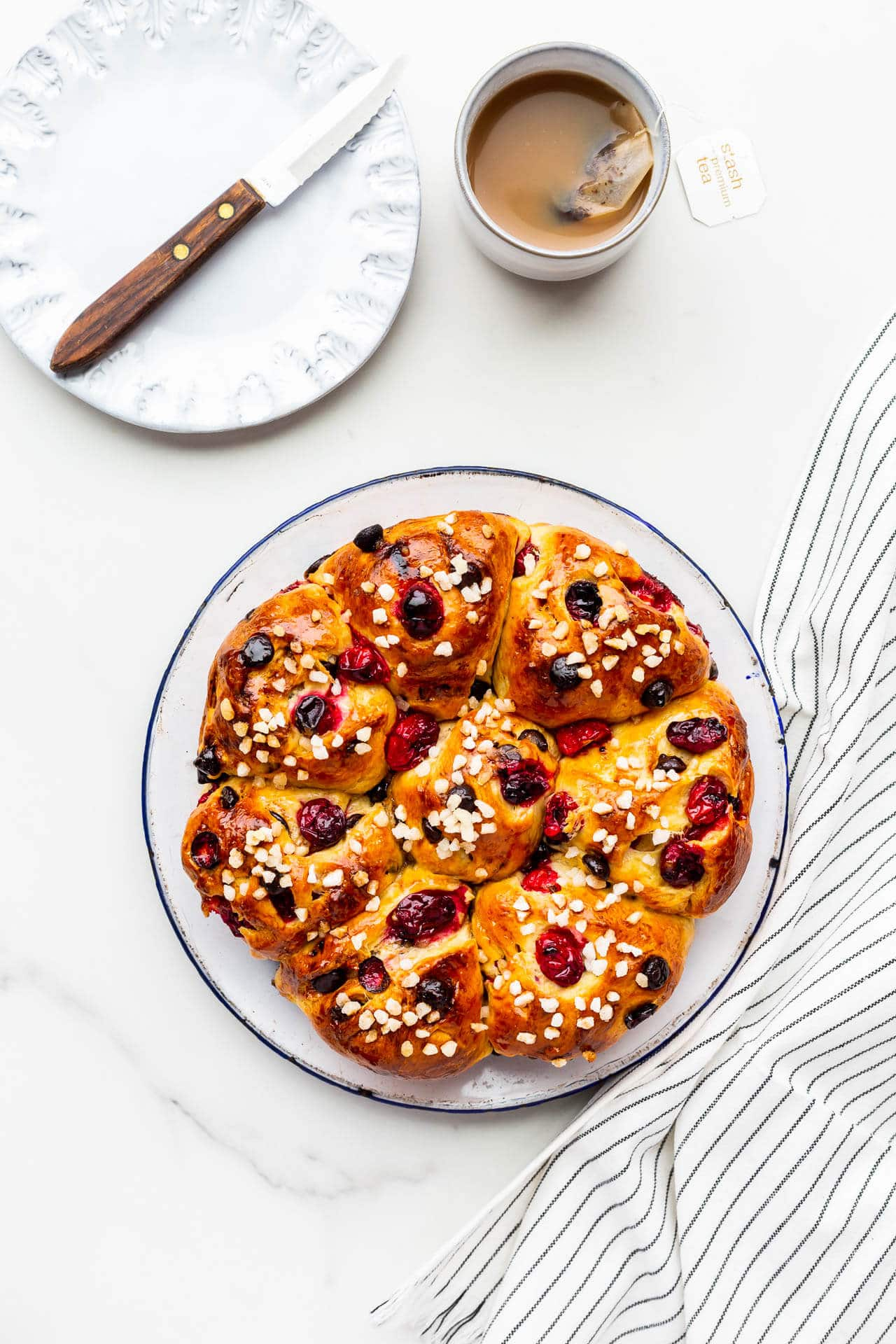 A plate with cranberry chocolate chip pull-apart brioche buns
