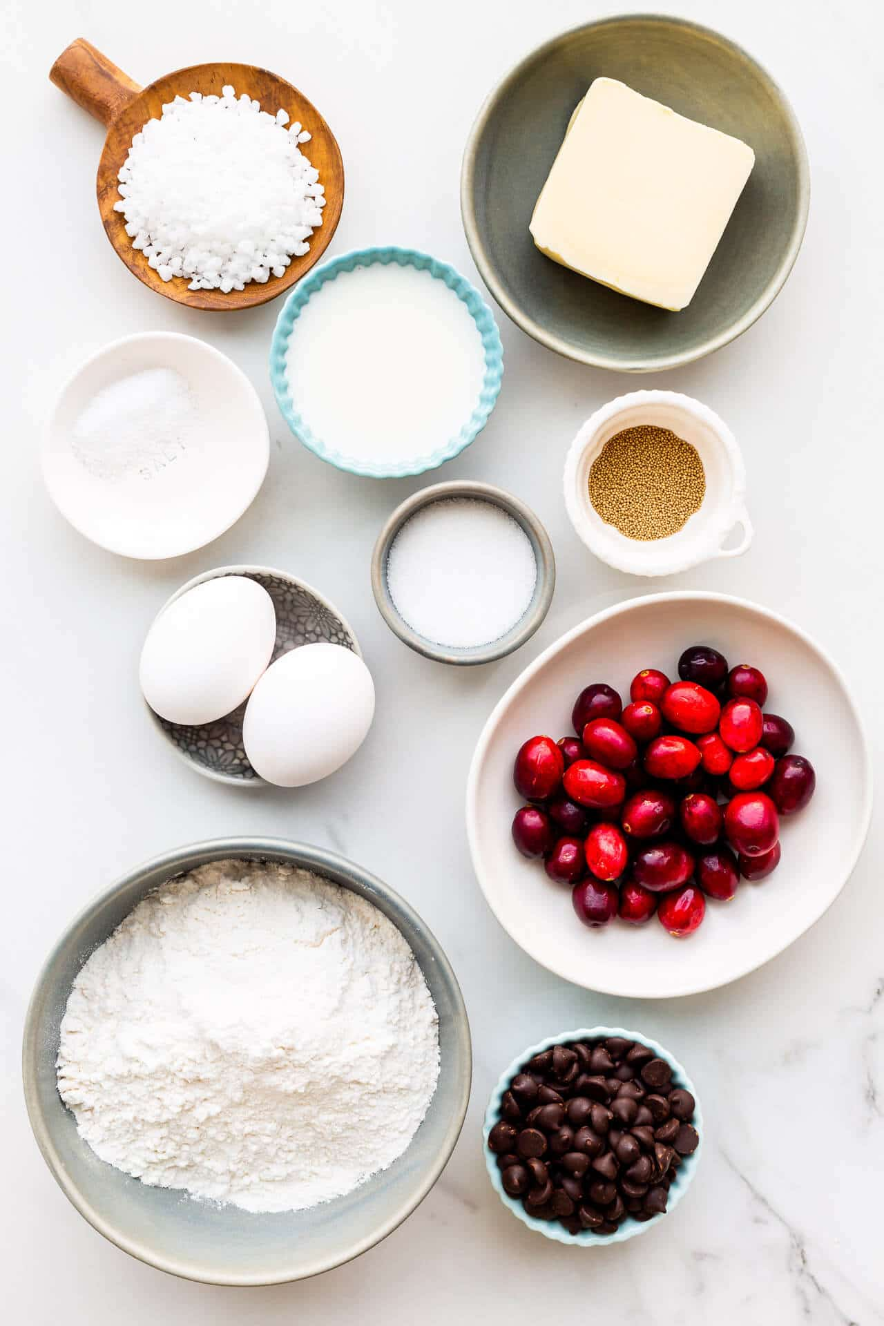 Ingredients to make chocolate cranberry bread buns measured out and ready to be used.