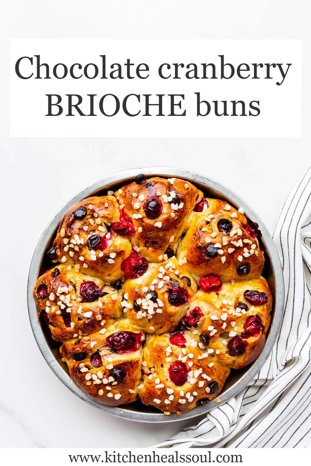 Chocolate cranberry brioche buns in a cake pan, freshly baked.