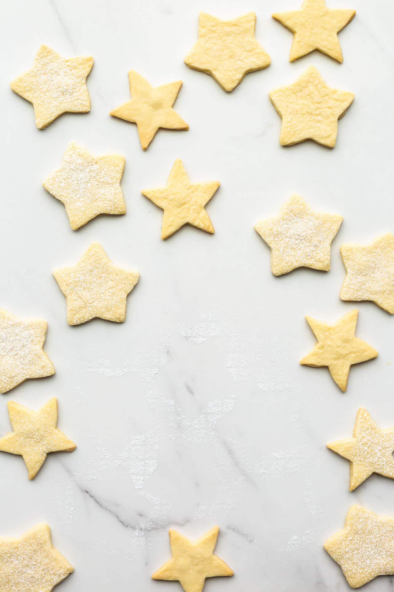 Shortbread stars on marble surface.