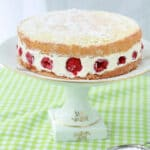 A fraisier cake with raspberries