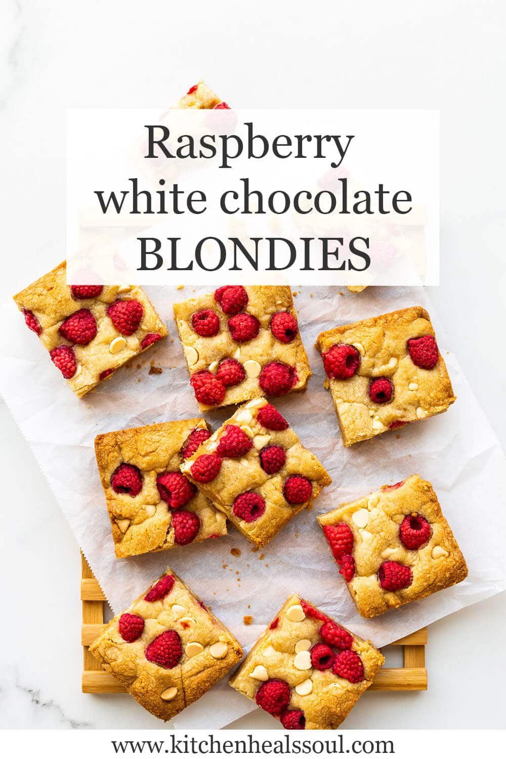White chocolate chip blondie bars topped with raspberries