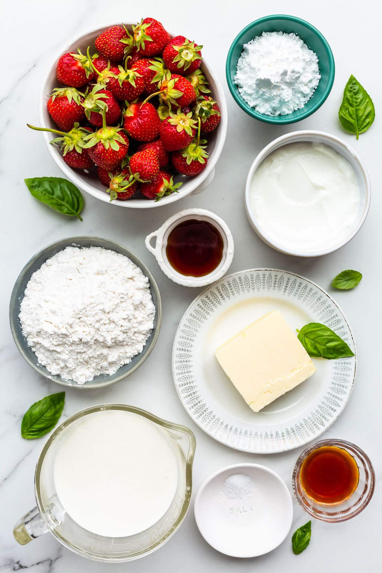 ingredients measured out for making a fresh strawberry tart with a shortbread cookie crust
