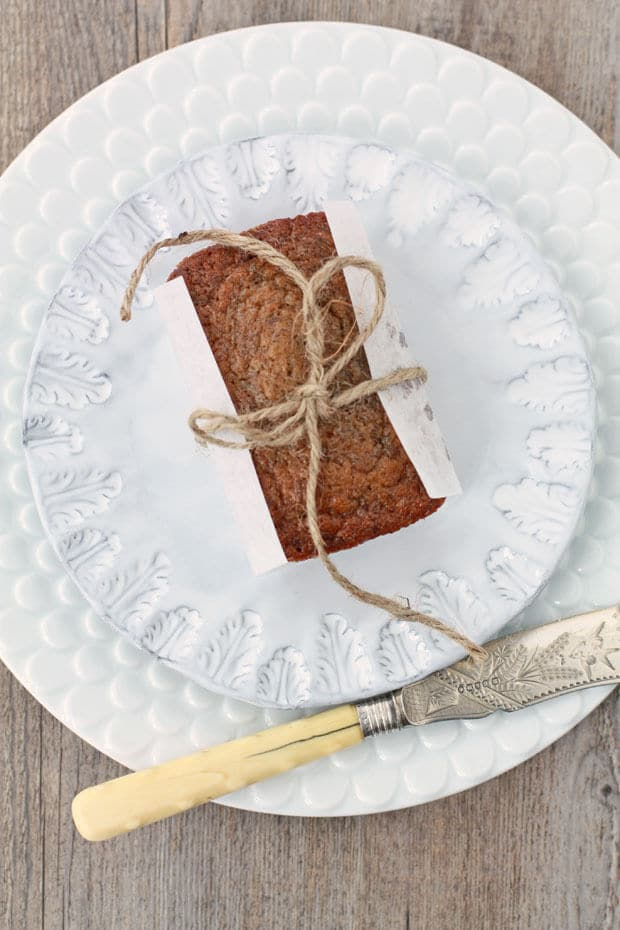 Top view of mini banana bread loaf wrapped in parchment tied with string