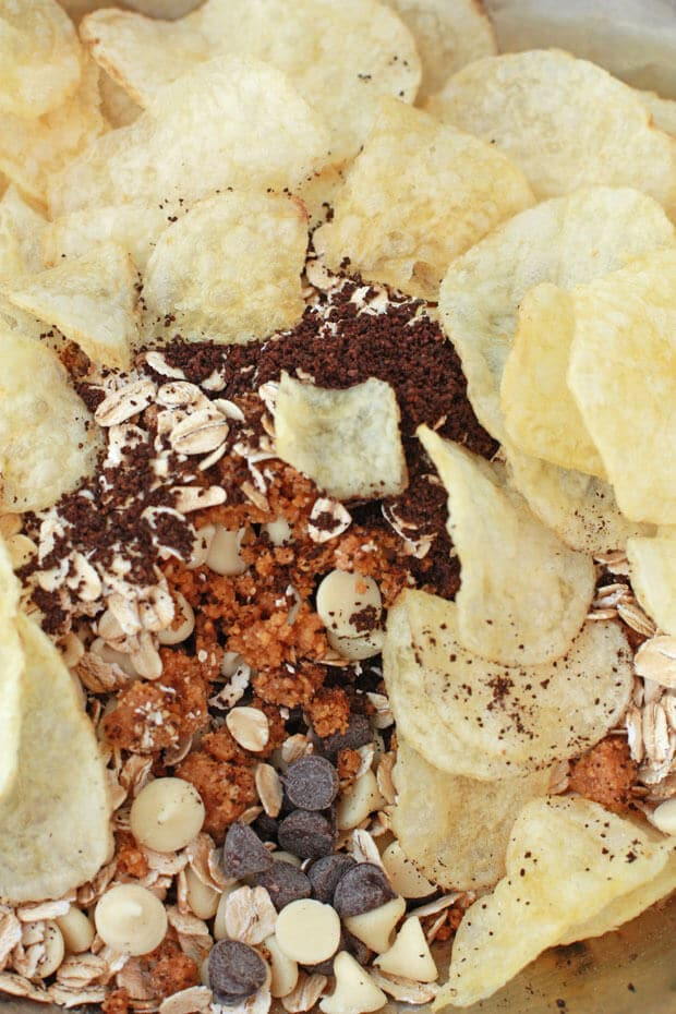 Compost cookies ingredients include potato chips, oats, graham cracker crust, chocolate chips, white chocolate chips, and even coffee grinds