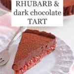Slice of rhubarb chocolate tart on a light blue ceramic plate with a fork, pink napkin