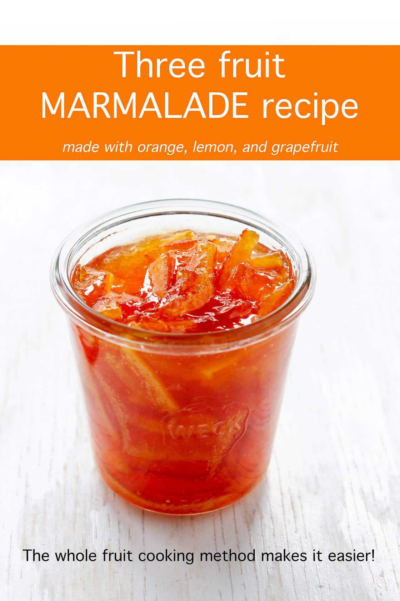 A glass Weck jar filled with lemon orange grapefruit marmalade (3 fruit marmalade) very