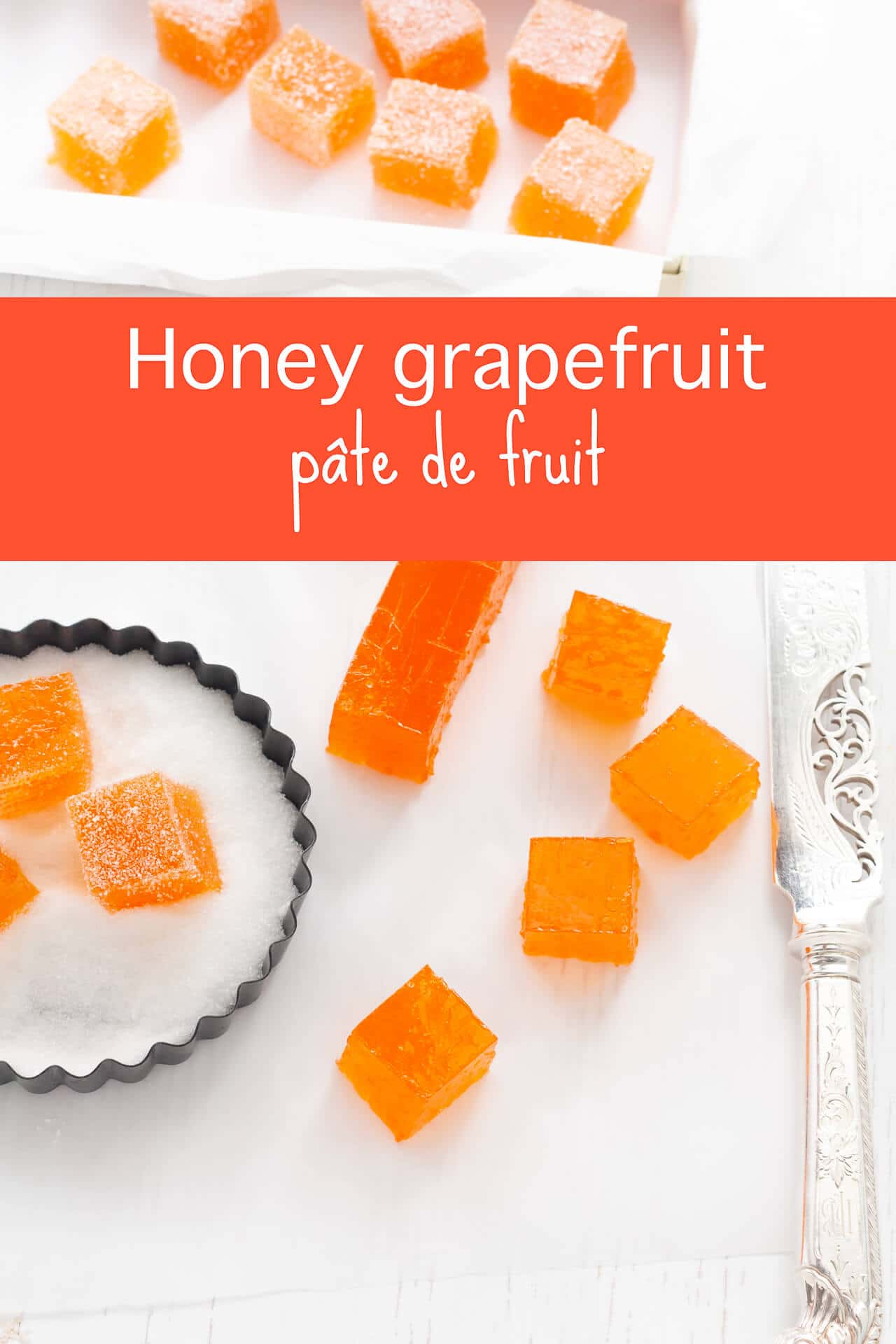Cutting homemade grapefruit pâte de fruit with a large knife, then dipping cubes of pâte de fruit in fine granulated sugar to coat the candy on all sides before serving