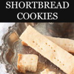 Traditional 3 ingredient shortbread cookies sliced into bars and poked with holes