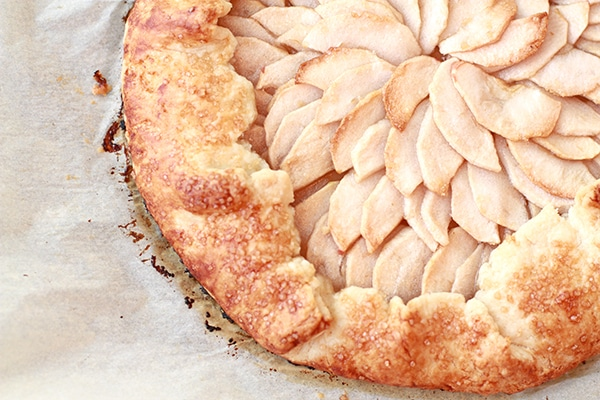 baked apple galette with apples arranged decoratively