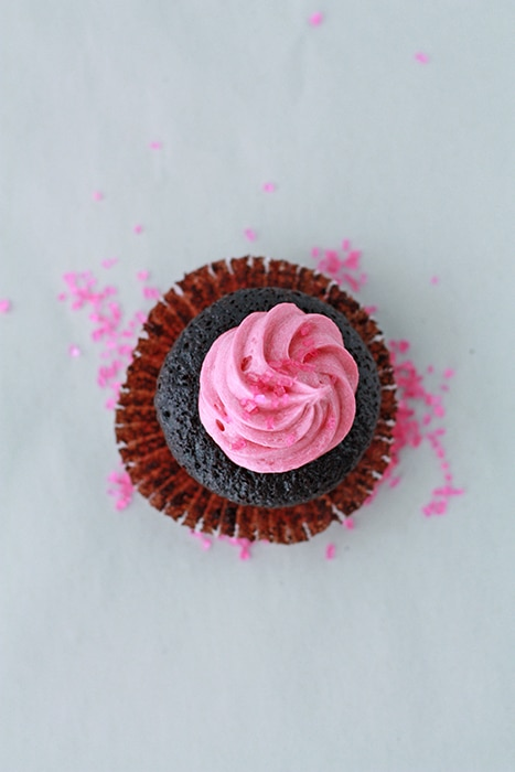 chocolate cupcakes with raspberry frosting view from above