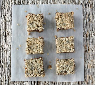 6 date squares set out on parchment paper.