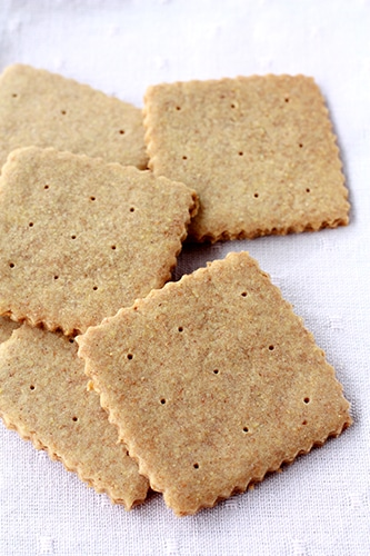 A scattered pile of homemade graham crackers