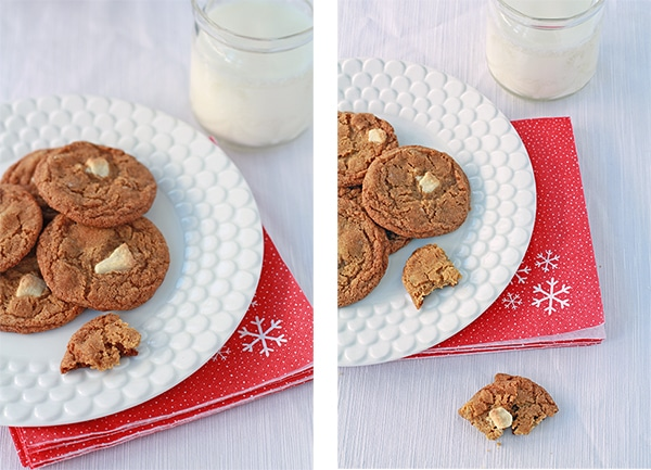 ginger cookies on white plate with glass of milk.