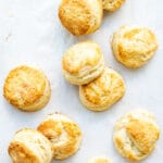 Golden brown homemade biscuits freshly baked on parchment paper