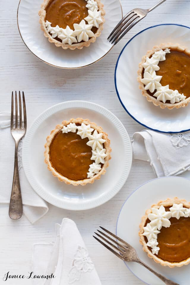 Little pumpkin tarts on white plates