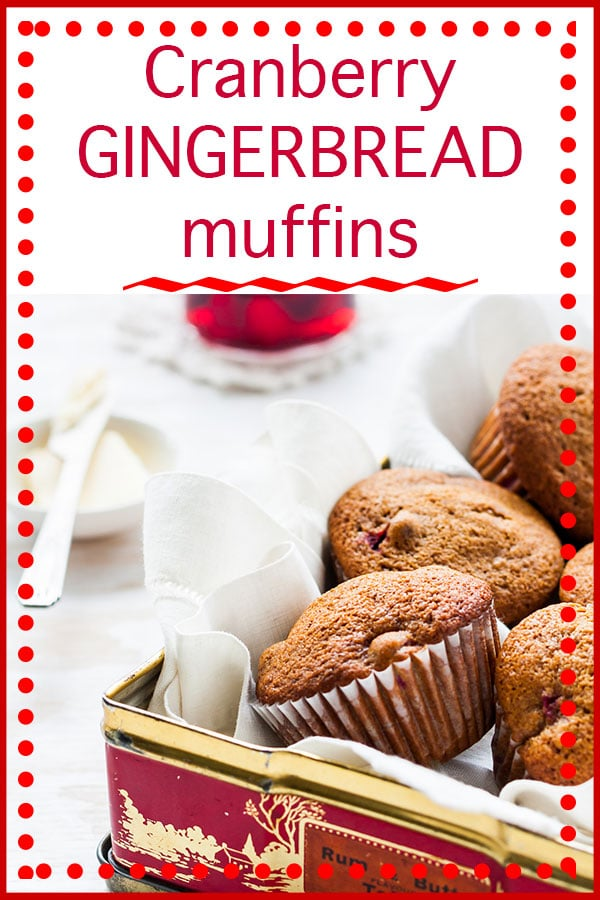 Cranberry gingerbread muffins stashed in a vintage red and gold tin, served with butter