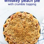 Whiskey peach pie with crumb topping and a crimped edge