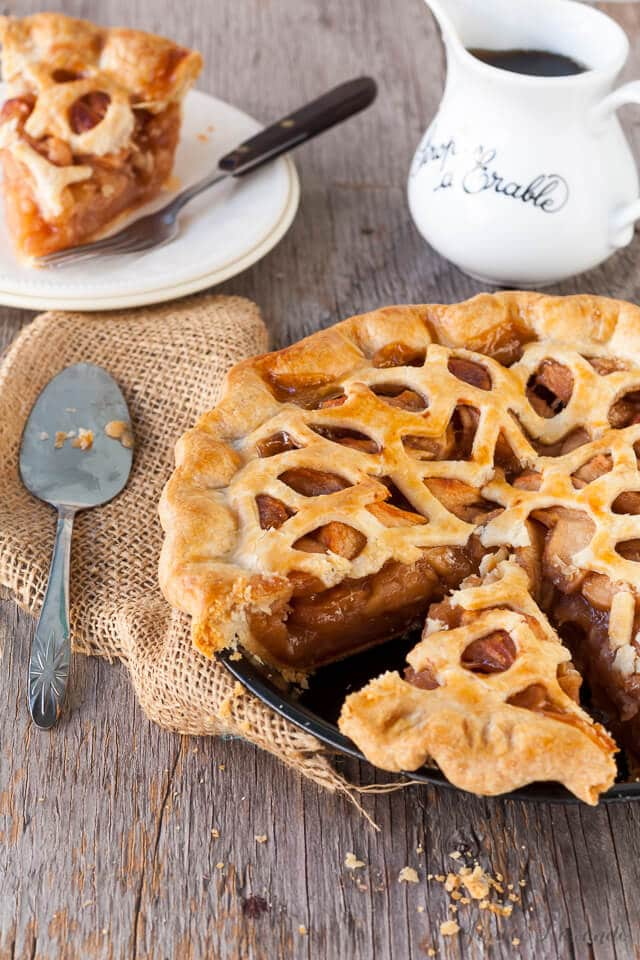Sliced maple apple pie being served.