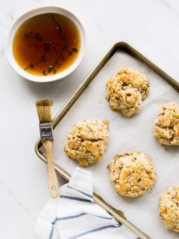 Bourbon-maple glazed cheddar bacon biscuits | bakeschool.com