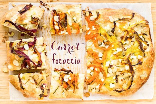 carrot focaccia with sliced almonds and feta cheese