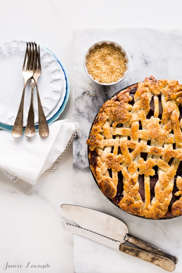 red wine-poached pear pie made with an all-butter flaky pie crust