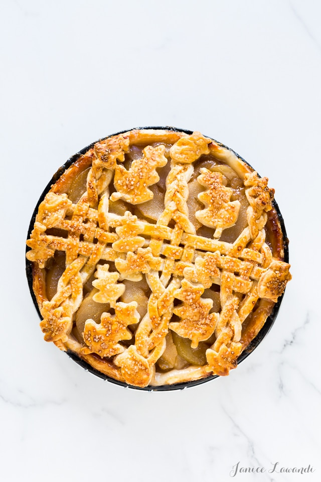rosé wine-poached pear pie made with an all-butter flaky pie crust