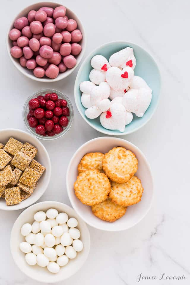 Cake decorating essentials - you can use candy and sweet snacks to decorate a layer cake. This is much easier than piping to decorate a cake.