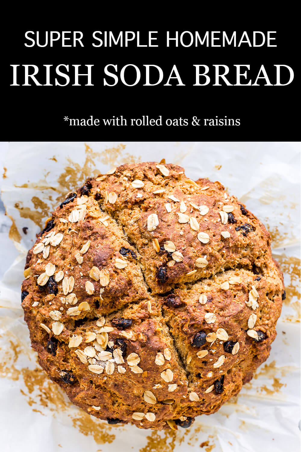 Golden brown loaf of homemade Irish soda bread with raisins and rolled oats scored into 4 sections