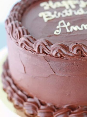 Chocolate caramel cake with chocolate frosting and caramel filling between the layers