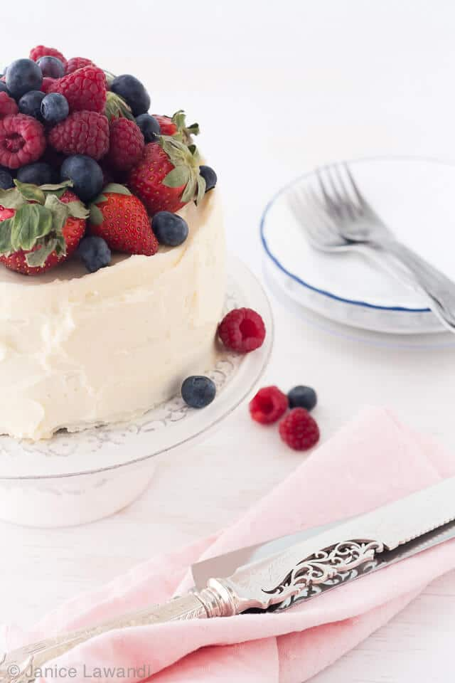 Chocolate layer cake with berries and cream cheese frosting