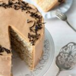 This Earl grey tea cake is a layer cake infused with Earl Grey tea. Earl Grey tea is used in the cake layers, in the Earl Grey frosting, and in the garnish.