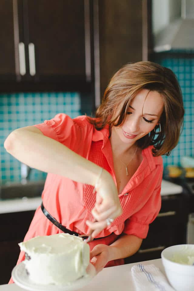 Janice Lawandi frosting a layer cake