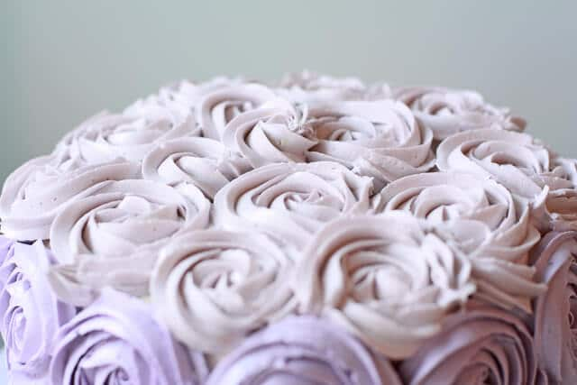 Italian meringue buttercream coloured pale lilac and piped on top of a cake to make a buttercream rose cake