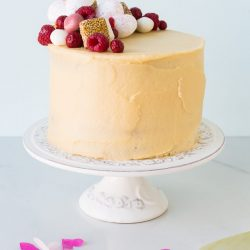 Sweet sesame layer cake with raspberries - this is a layer cake recipe flavoured with sesame butter (tahini), raspberries, and a little honey. Makes a beautiful birthday cake for adults.