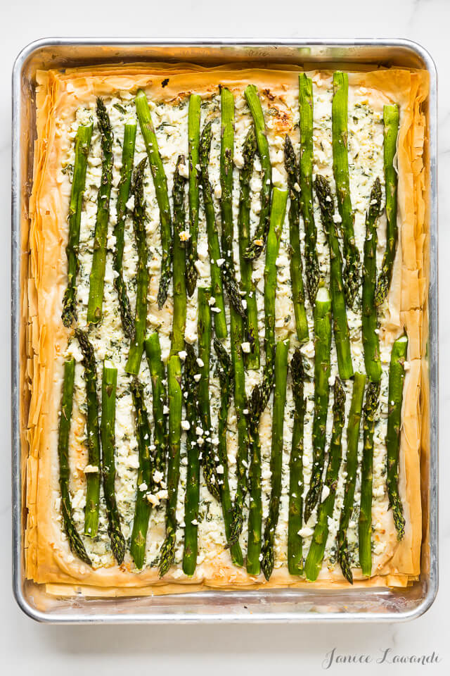Asparagus phyllo tart with ricotta, feta, herbs, and lemon zest, baked