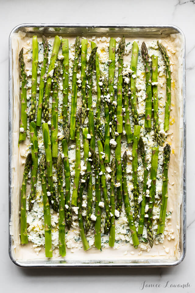Asparagus phyllo tart with ricotta, feta, herbs, and lemon zest, before baking