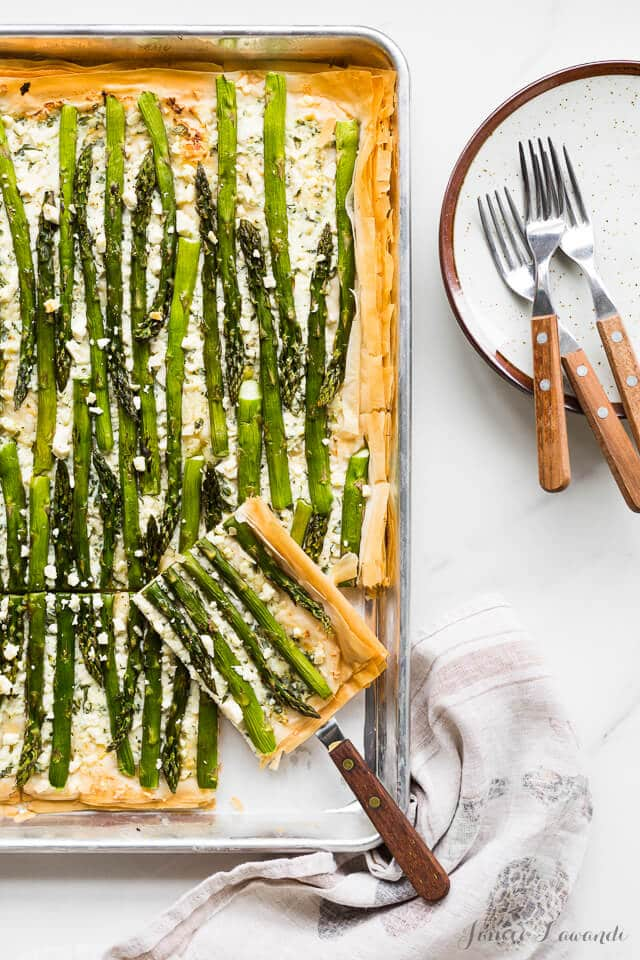 Asparagus phyllo tart with ricotta, feta, herbs, and lemon zest, cut into slabs
