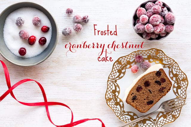 Slice of cranberry chestnut loaf cake with sugared cranberries in bowls
