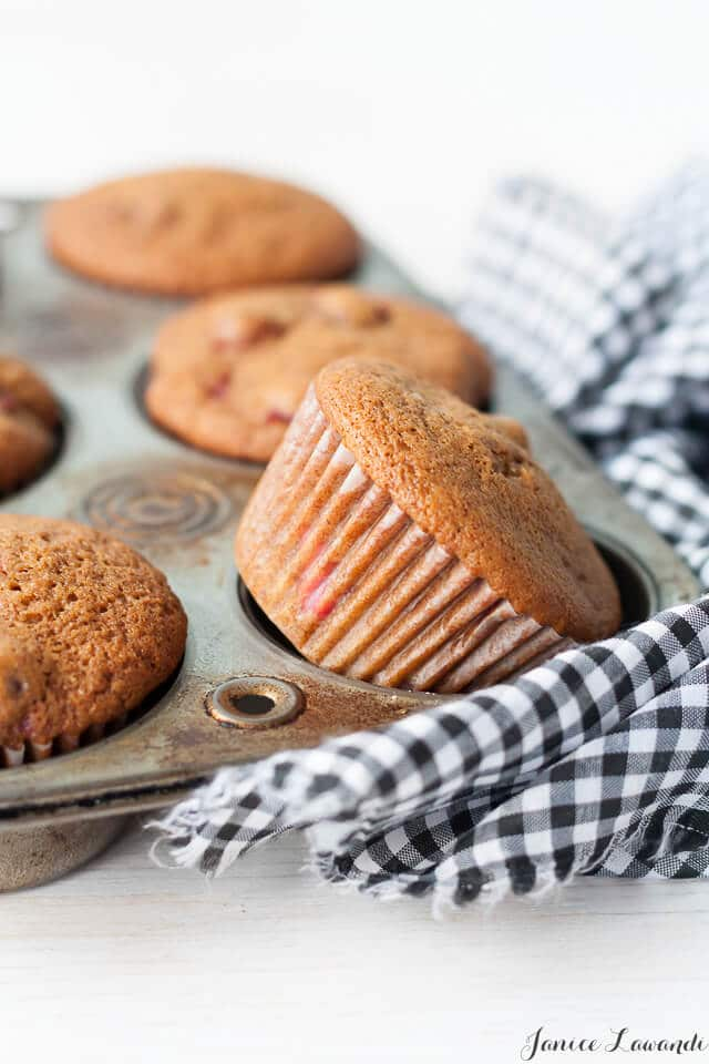 Gingerbread cranberry muffins flavoured with gingerbread spices, molasses, and tart cranberries