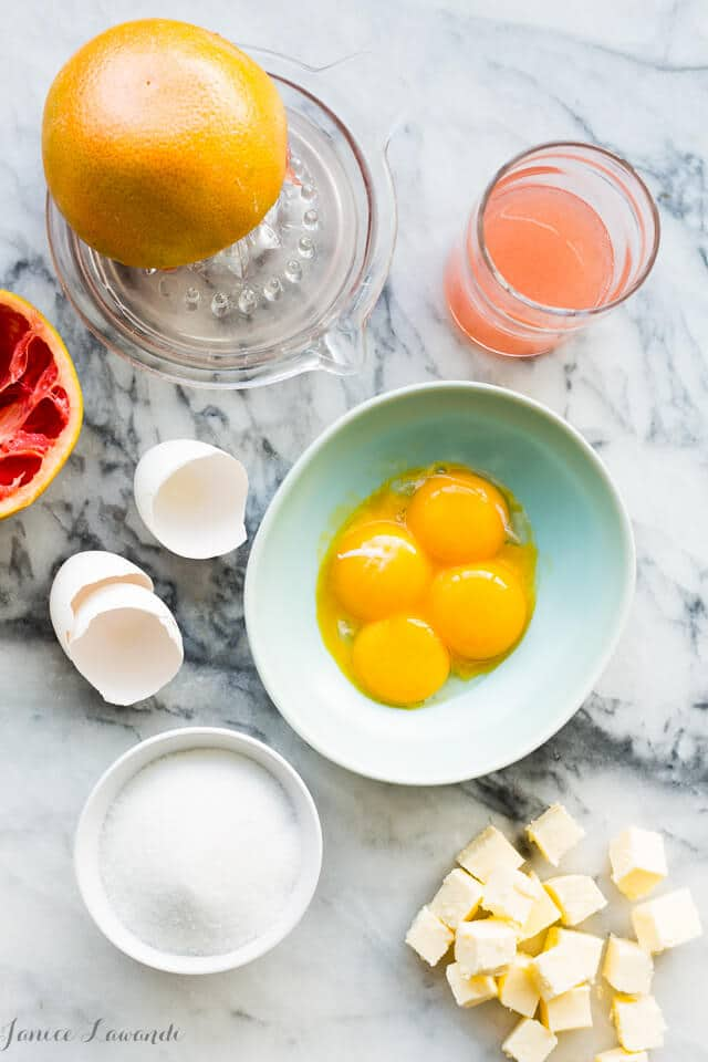 Grapefruit curd ingredients (grapefruit juiced, egg yolks, sugar, and cubes of butter