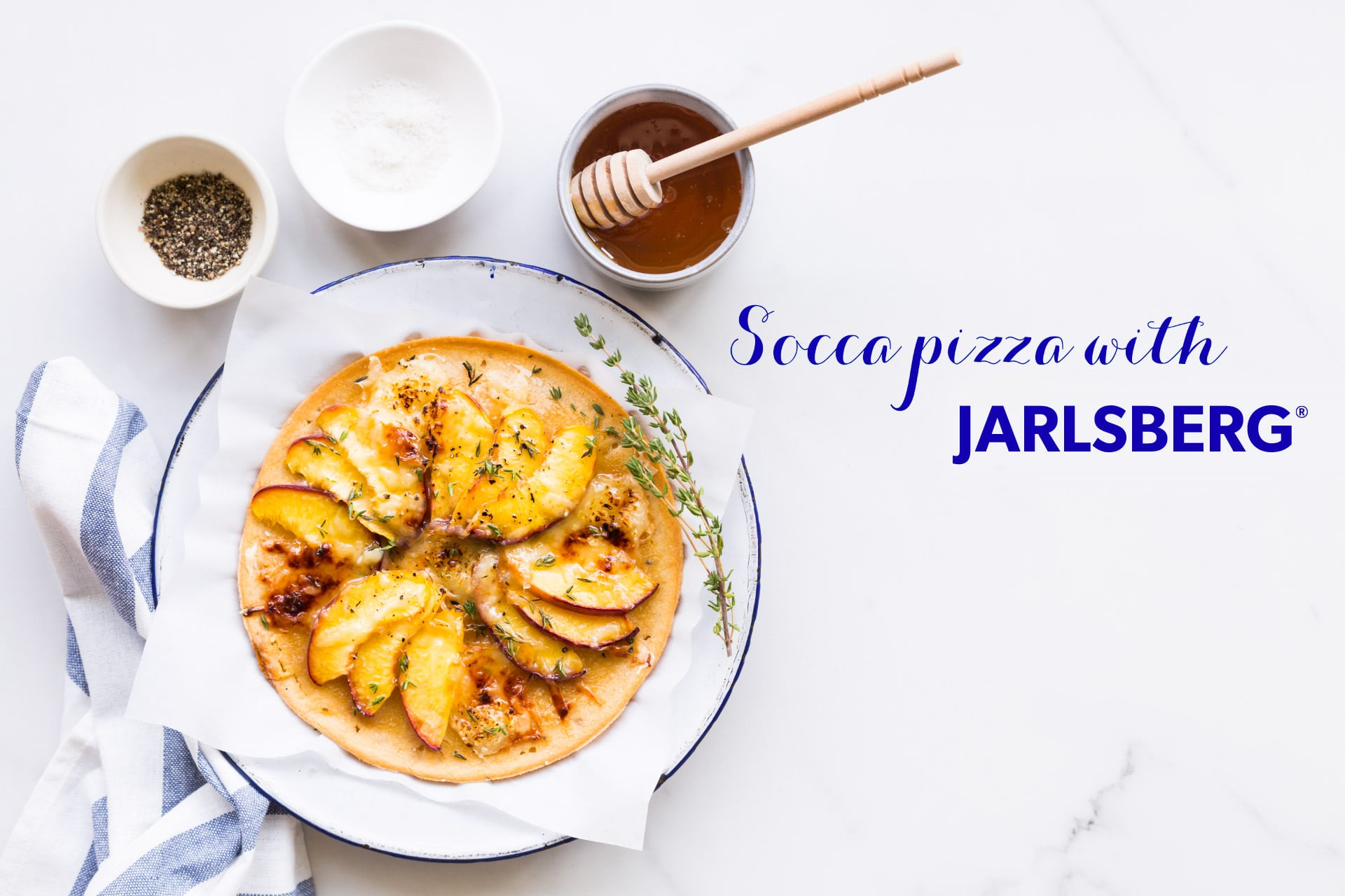 Gluten-free socca pizza with nectarines and Jarlsberg cheese