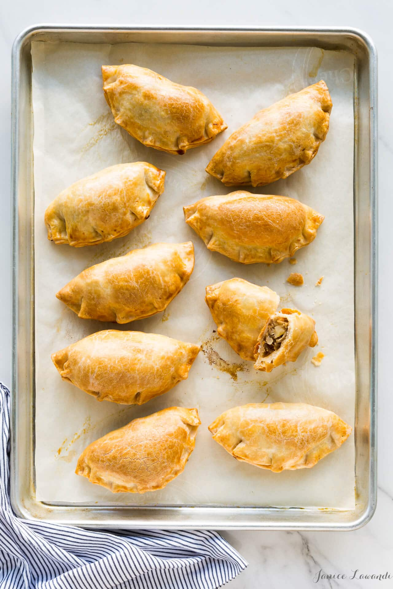 Freshly baked golden brown savoury hand pies with Maple Leaf shredded pork, thyme and apple chunks