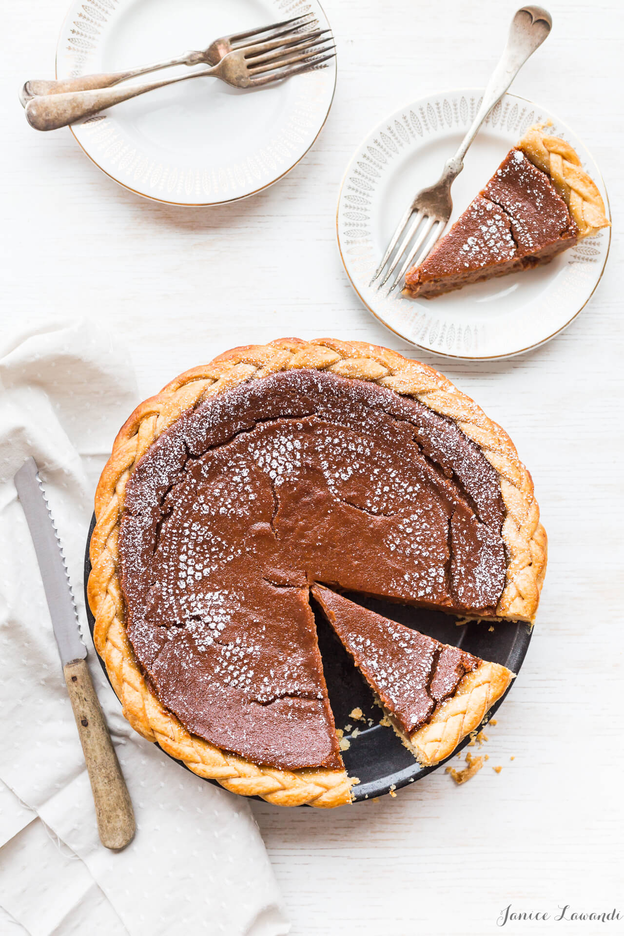 Apple butter pie - Stencil pie with powdered sugar to give it a lacy pattern, sliced and served on white plates