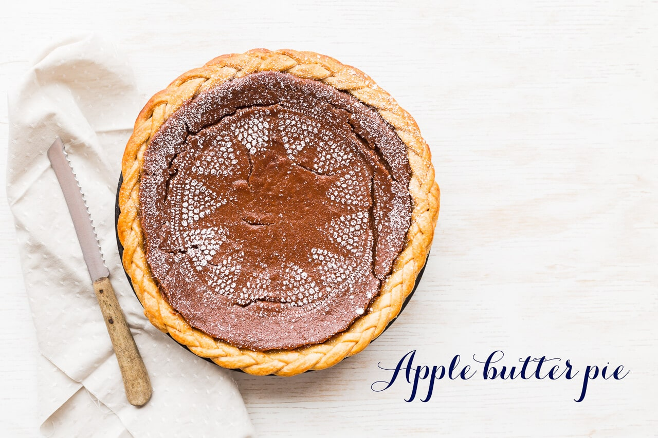 Apple butter pie with braided edge and lace stenciled on with powdered sugar