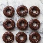Baked chocolate donuts glazed with chocolate ganache
