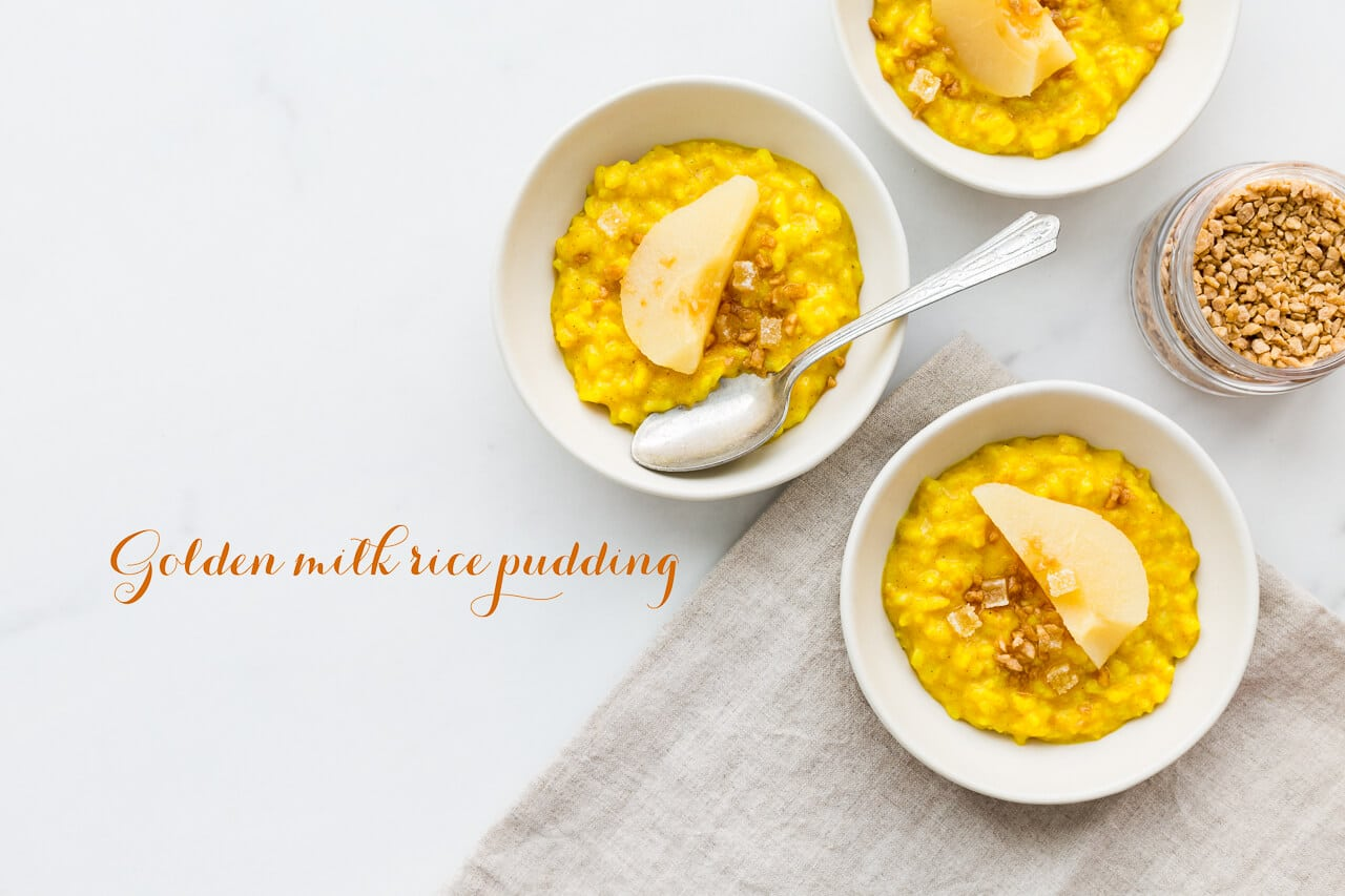 Golden milk rice pudding made with leftover rice and spiced with turmeric, ginger, cardamom, and cinnamon, served with poached pear